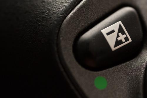 Exposure compensation button