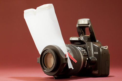 A pop-up flash diffuser for macro photography made from part of a plastic milk bottle and an elastic band