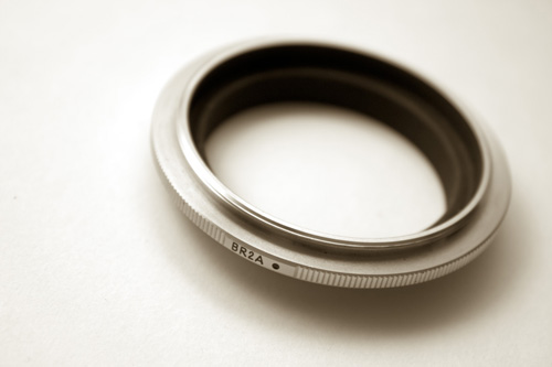 The Nikon BR-2a is an example of a reverse mount adapter for Nikon DSLRs. Similar adapters are available for all interchangeable lens cameras.