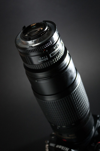 Zoom lens with a reversed 50mm lens mounted in front