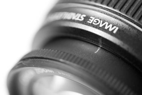 Infinity focus point marked in pencil on the lens barrel of a modern lens with no focusing scale.