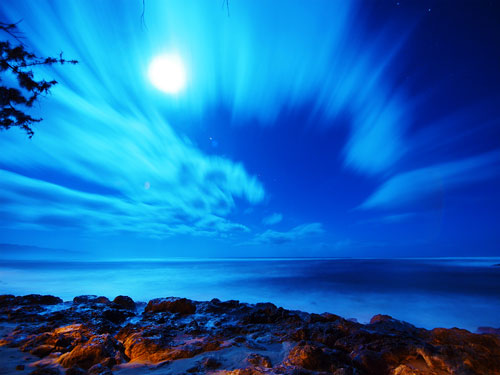 Blurred clouds seascape at night