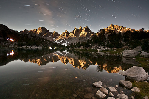 Kearsarge Pinnacles by Moonlight with reflection broken by rocks in foreground