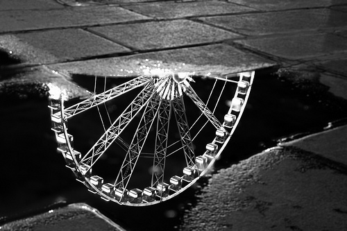 "Reflection of the ""Grande Roue de Paris"" in a puddle"