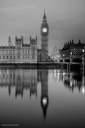 Big Ben reflected in the Thames, framed with a symmetrical composition