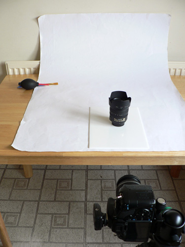 The white card backdrop on the table. I have also used a piece of white acrylic under the subject.
