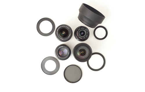 Lenses with different size filter threads, step up rings, filter, and a rubber lens hood