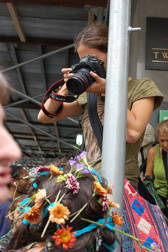 Photographer using a camera where the logos have been taped over