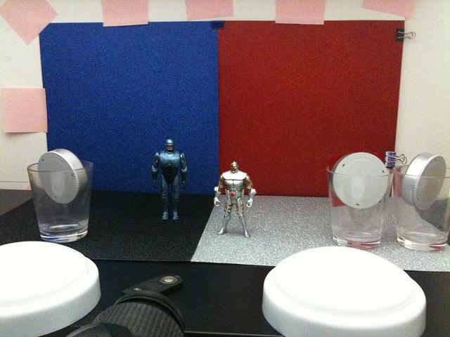 RoboCop vs. Cyborg action figure tabletop photography setup