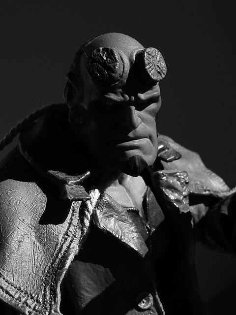 Hellboy action figure with harsh lighting to create a dark mood