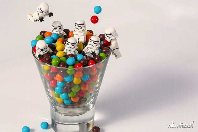 party time! - Lego storm troopers jumping in a glass of M&Ms