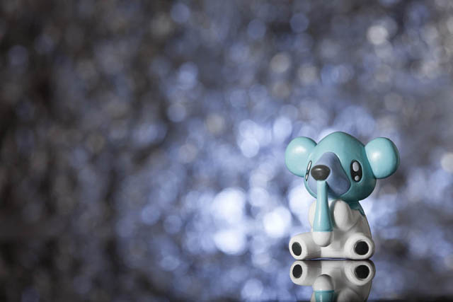 Pokemon toy with a sparkly blue background