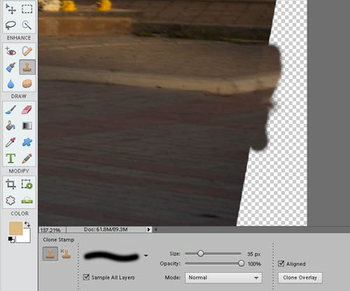 Using the clone tool to fill in the empty area created by the distortion correction