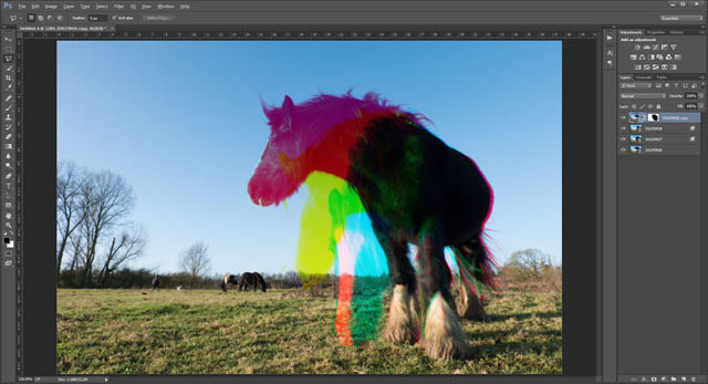 Three different photos of a horse combined into a single image as red, green, and blue layers
