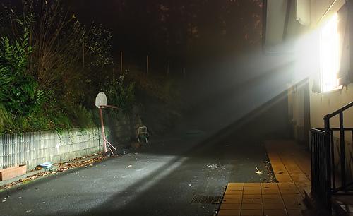 fog at night - light beam from a window