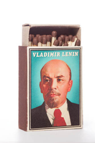 Close-up photo of a Lenin matchbox with a seamless white background