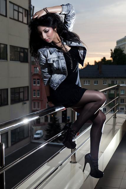 Female portrait taken around twilight with ungelled flash