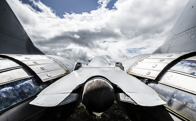 F14 Tomcat aircraft photographed close up using a wide angle focal length to create a dramatic image