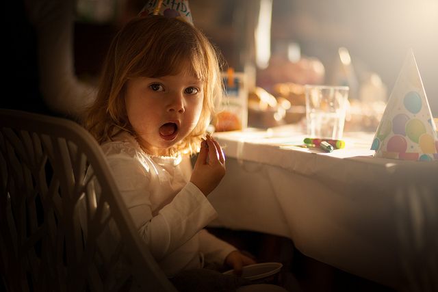 Girl at a birthday party, photographed using an 85mm fixed focal length prime lens