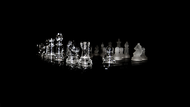 Low key, wide angle, shallow DoF photo of a chess set