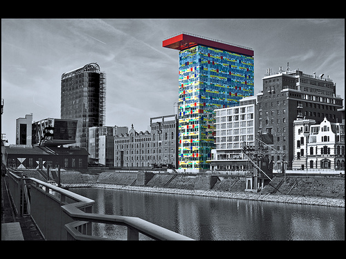 Selective color photo of buildings along a waterfront