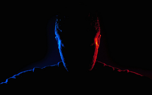 Silhouette portrait photograph taken using two flashes, one gelled red, and one gelled blue