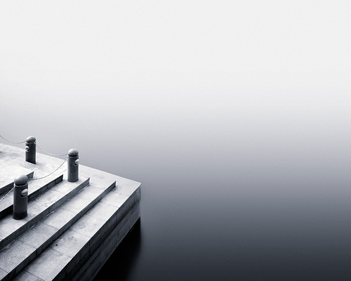 Steps and water, with a smooth gradient across the water surface and stronger contrast on the steps