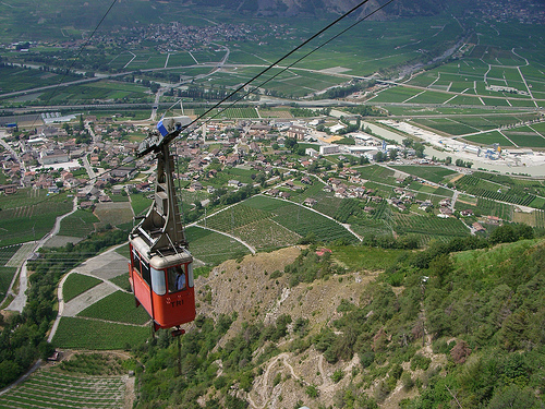 Cable car traveling up a mountain