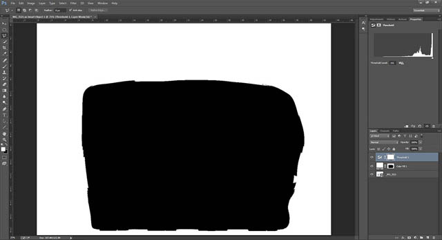 A black blob surrounded by white - image with Threshold adjustment layer shows that all of the center of the image is not pure white, but the edges are