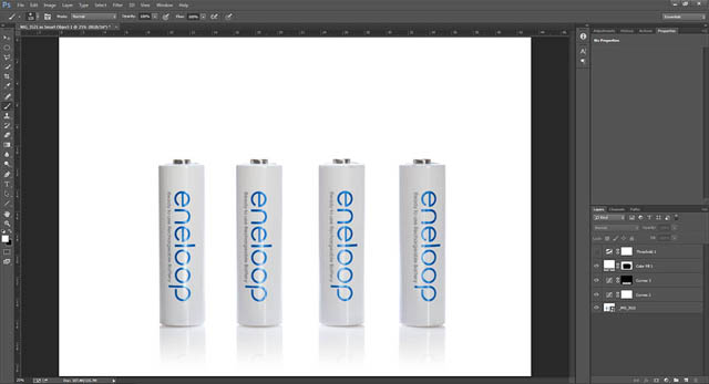 Photo of white Sanyo Eneloop batteries on white background in Photoshop with edits to make background pure white and Threshold adjustment layer hidden