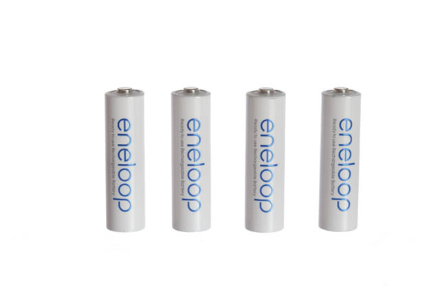 Photo taken of white batteries on a transparent surface with a white background