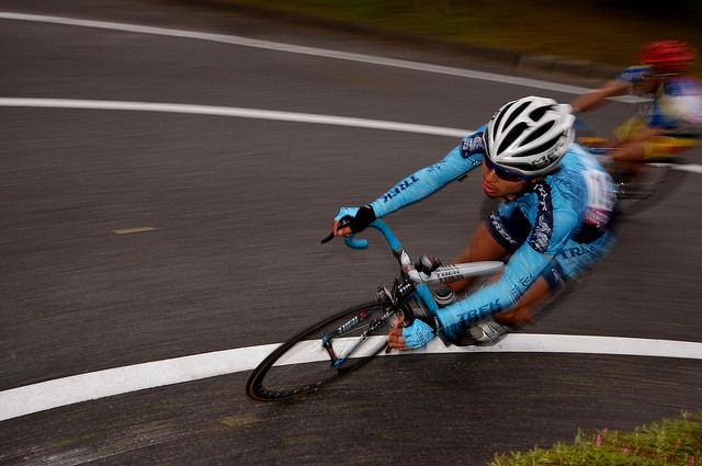 Cyclist captured using a combination of panning and rear sync flash