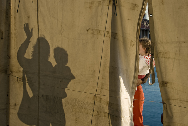 Photo of a shadow on the wall of a tent, photographed from inside the tent