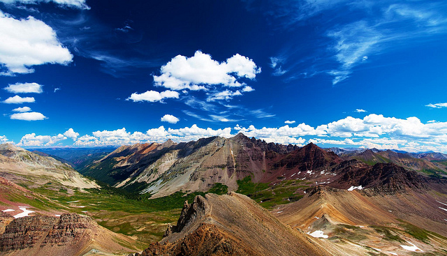 Photo looking out from near Colorado's triangle pass summit, taken using a polarizing filter for saturated colors and a deep blue sky