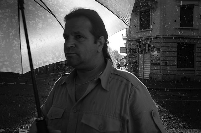 Street photography portrait - summer rain