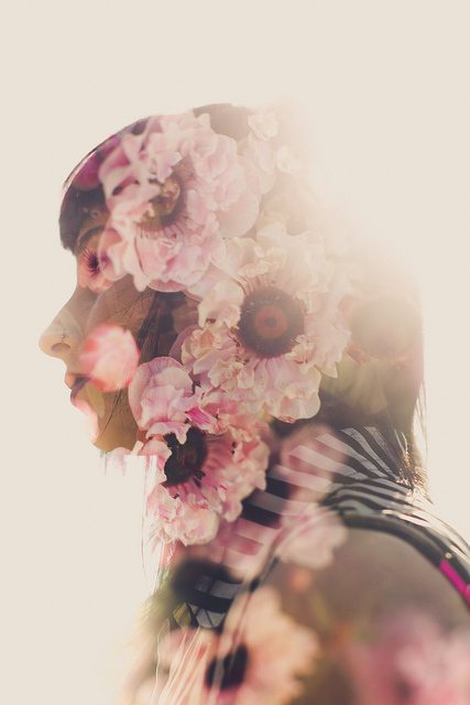 In-camera double exposure photograph of a portrait and flowers