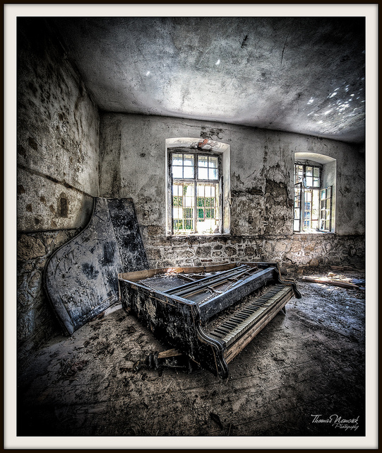 Decaying piano in abandoned building HDR urbex photo