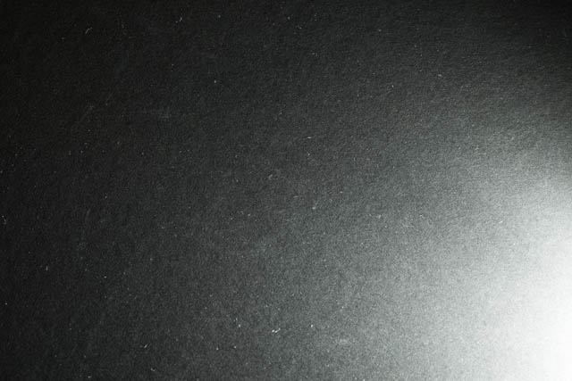 Piece of black card lit by Speedlight fired at full power, the color temperature is slightly warmer than the previous image