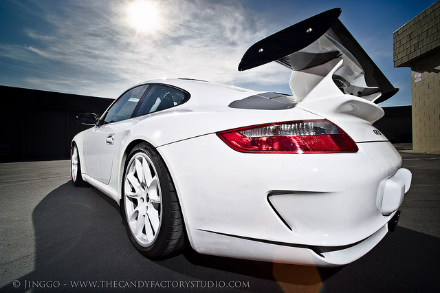 Porshe 911 GT3, studio strobes used to light the shadow side of the car and overpower the sun