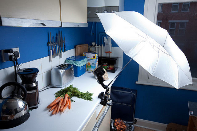 Carrots lighting setup - a speedlight flash and umbrella superclamped to the edge of a work surface in the kitchen