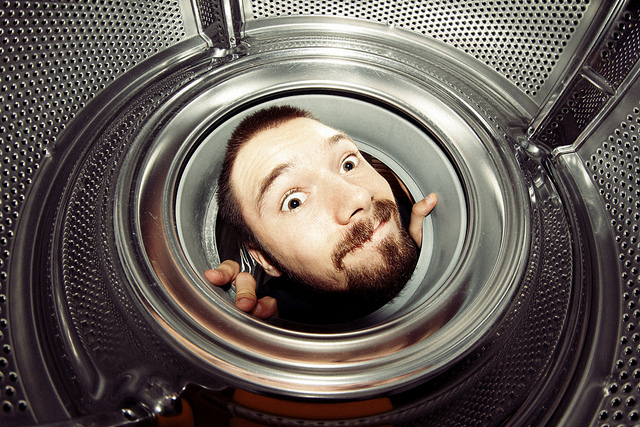 Fisheye Fun - Portrait taken from inside washing machine of man looking into it