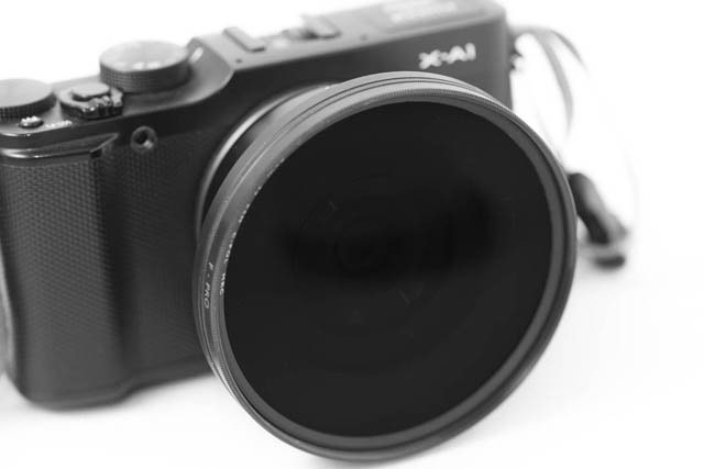 Camera with a small pancake lens attached but then a large filter attached to it using step-up rings