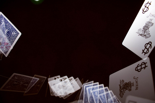Flying playing cards photographed using stroboscopic flash