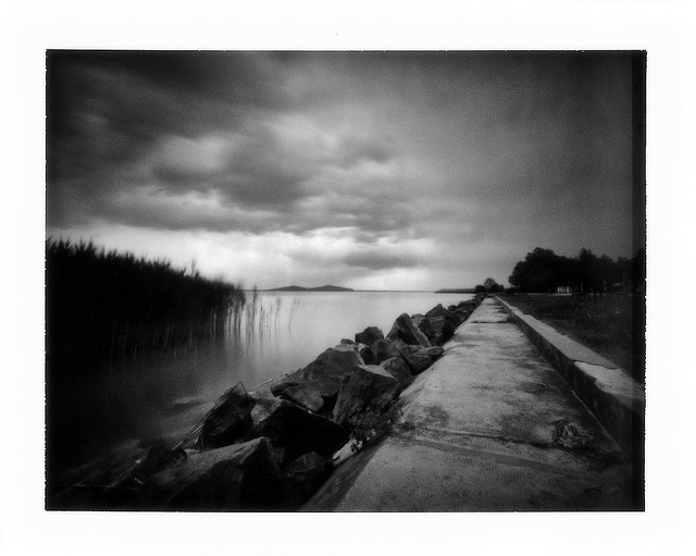Rain above the twin mountains in the far-far distance - moody pinhole landscape photo
