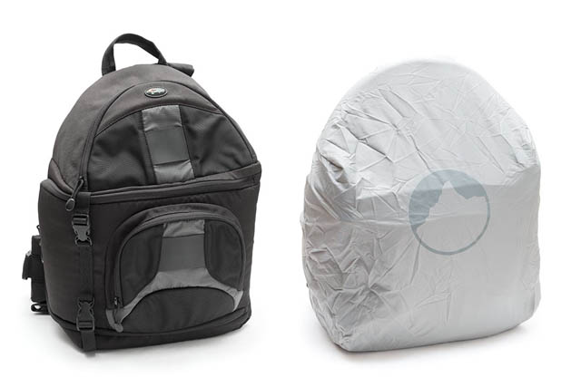 Bag with a built-in rain cover that extends out from a pocket at the bottom of the bag, before adding the rain cover and after.