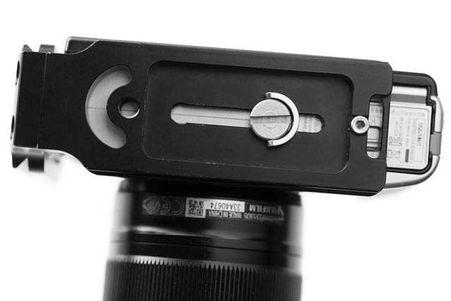 Example of a Quick release plate and camera combination where the plate blocks the battery and memory card door - the plate needs removing to change the battery or memory card.