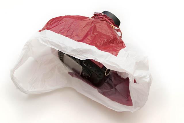 Using a plastic bag as a camera rain cover
