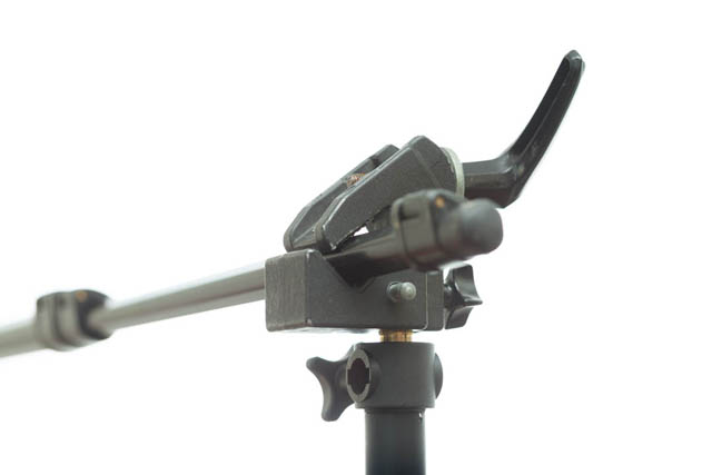 Superclamp mounted on light stand and clamped onto monopod leg to hold it out horizontally as a boom arm