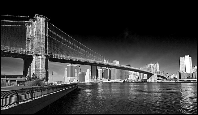 Black & White photo of Brooklyn Bridge taken using a red filter to give darker sky and water