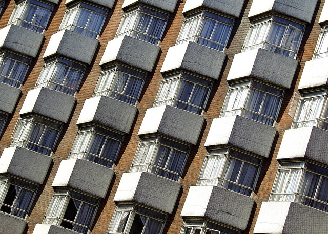 Windows on a block of flats, tilted at an angle to give a more pleasing composition